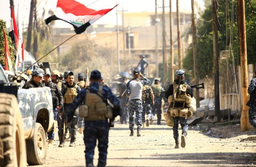 Federal police members are seen during a battle with Islamic State militants in Mosul, Iraq, March 6, 2017 (photo credit: REUTERS)