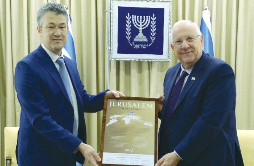 PRESIDENT REUVEN RIVLIN and Christians for Israel International chairman Leon E. Meijer hold the organization's 'Jerusalem Declaration' at the President's Residence. (photo credit: MARK NEYMAN/GPO)