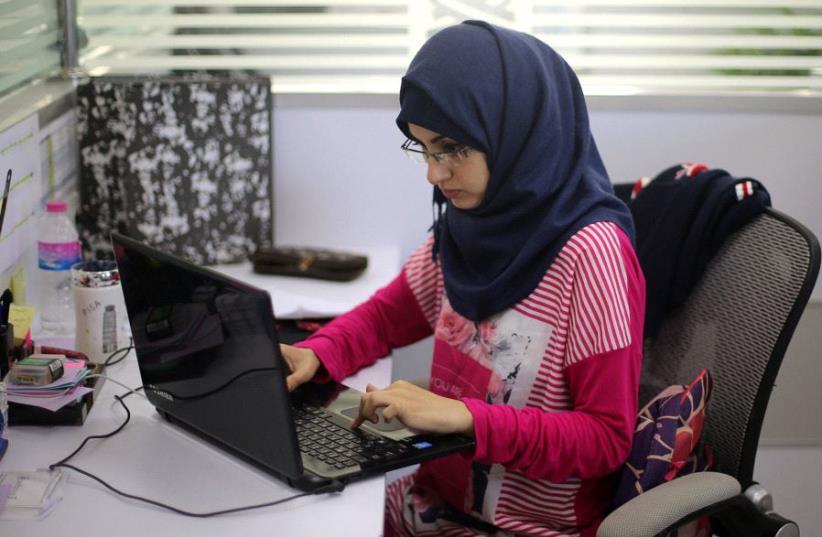 "Palestinian entrepreneur Samar Hijjo, who developed the mobile application ''Baby Sitter""  (photo credit: REUTERS)"