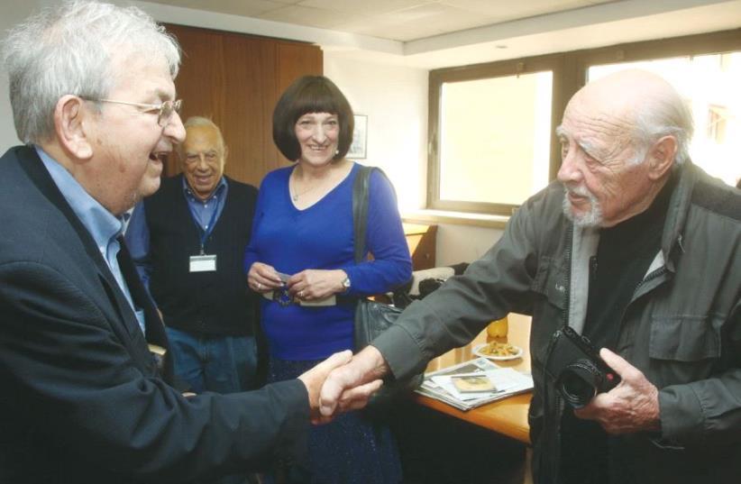 FORMER 'JERUSALEM POST' editor-in-chief Ari Rath (left) greets legendary photographer David Rubinger at the offices of the 'Post.'  (photo credit: MARC ISRAEL SELLEM/THE JERUSALEM POST)