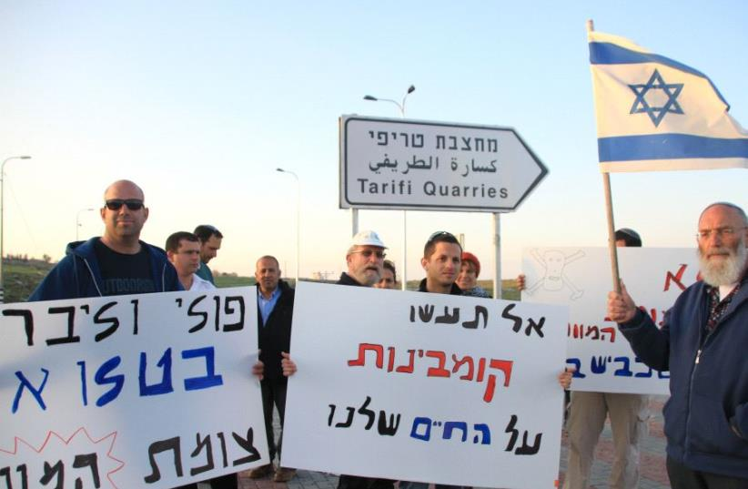 Settlers holding a small demonstration on the new paved turn-off to the road (photo credit: TOVAH LAZAROFF)
