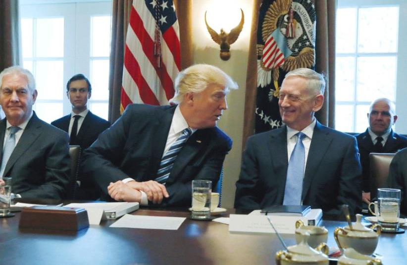 US PRESIDENT Donald Trump holds a cabinet meeting at the White House this week. (photo credit: REUTERS)