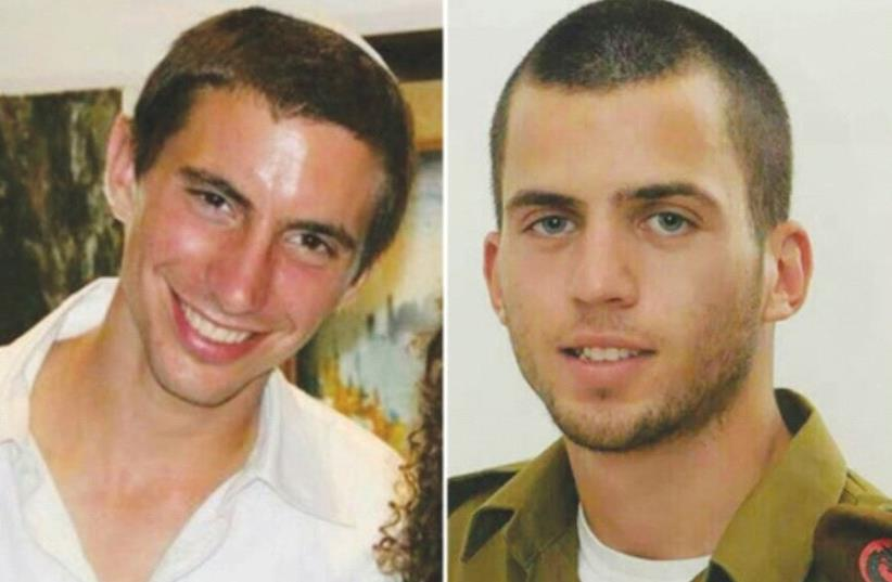 Lt. Hadar Goldin (left) and St.-Sgt. Oron Shaul were killed in action in the war against Hamas in 2014 (photo credit: Courtesy)