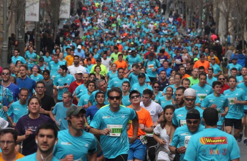 Runners in the 2017 Jerusalem marathon (photo credit: MARC ISRAEL SELLEM/THE JERUSALEM POST)