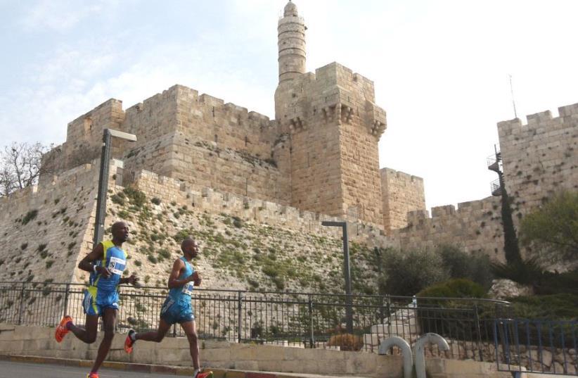 Runners in the Jerusalem Marathon  (photo credit: MARC ISRAEL SELLEM)