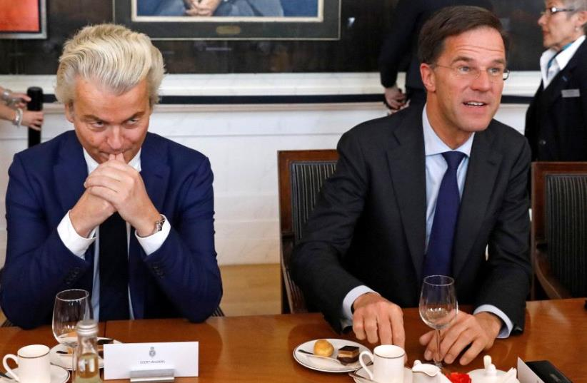 Dutch Prime Minister Mark Rutte (R) of the VVD Liberal party and Dutch far-right politician Geert Wilders of the PVV Party (photo credit: REUTERS)