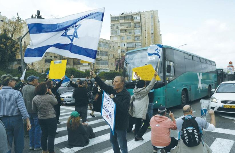 ISRAEL BROADCASTING AUTHORITY employees block the street during a protest against the Histadrut labor federation in Jerusalem yesterday. (photo credit: REUTERS)