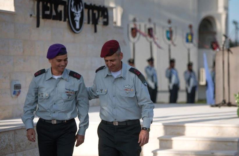 MAJ.-GEN. YOEL STRICK (left) walks with his predecessor at the Northern Command, Maj.-Gen. Aviv Kochavi, at the unit's headquarters in Safed yesterday. (photo credit: IDF)