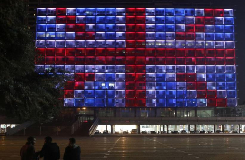 The building of the city hall in Tel Aviv's Rabin square in Israel is illuminated in solidarity with Britain for the attack on Westminster Bridge in London March 22, 2017 (photo credit: REUTERS)