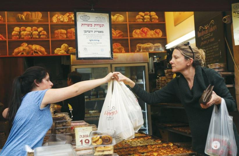 A Kashrut certificate hangs at the entrance to a bakery in Jerusalem's Mahaneh Yehuda market (photo credit: MARC ISRAEL SELLEM)