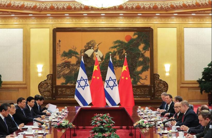 CHINESE AND ISRAELI officials meet at the Great Hall of the People on Monday in Beijing. Israeli businessmen who accompanied the delegation reportedly signed deals worth some NIS 7.3b (photo credit: REUTERS)