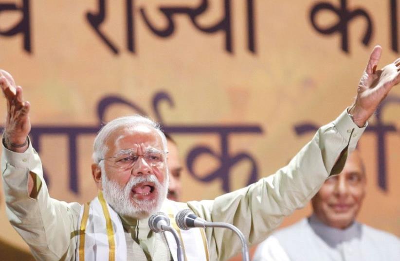 INDIA'S PRIME MINISTER Narendra Modi addresses supporters at BJP headquarters in New Delhi on March 12. (photo credit: REUTERS)