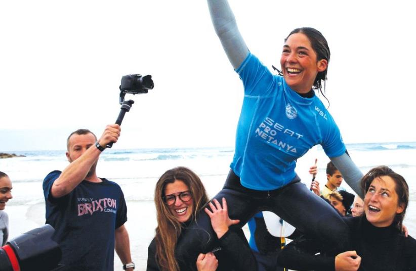 Garazi Sanchez-Ortun, a surfer from the Basque Country 'paves her own path' and celebrates after winning the women's finals in the World Surf League Pro Netanya, in the Mediterranean Sea, off the coast of Netanya earlier this year (photo credit: REUTERS)