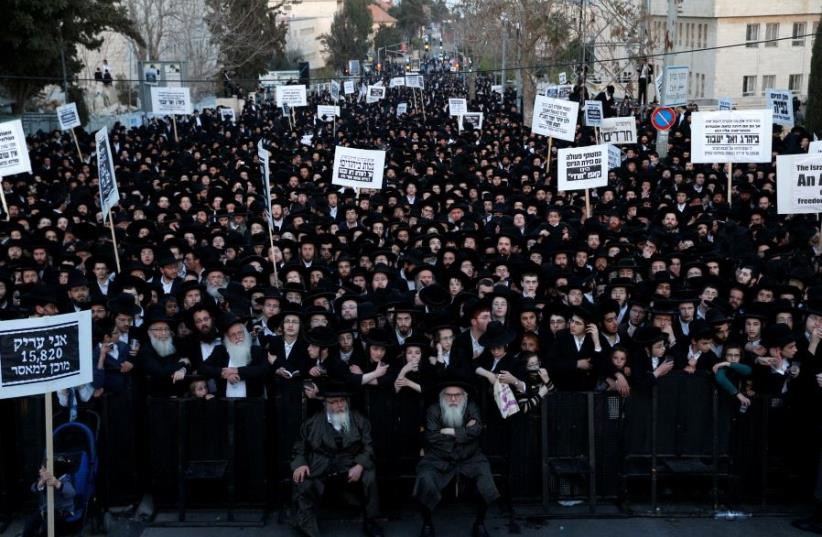 Ultra-Orthodox Jewish protesters take part in a demonstration against members of their community serving in the Israeli army, in Jerusalem (photo credit: REUTERS)
