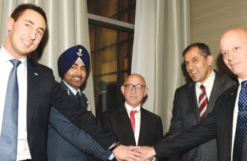 SMILING IN HERZLIYA on Tuesday night are (from left) ISDEF President Tomer Avnon, Indian Ambassador Pavan Kapoor, acting NSC head Yaakov Nagel, Indian military attaché Tejpal Singh and ISDEF marketing CEO Jonas Zilkin. (photo credit: STUDIO A)