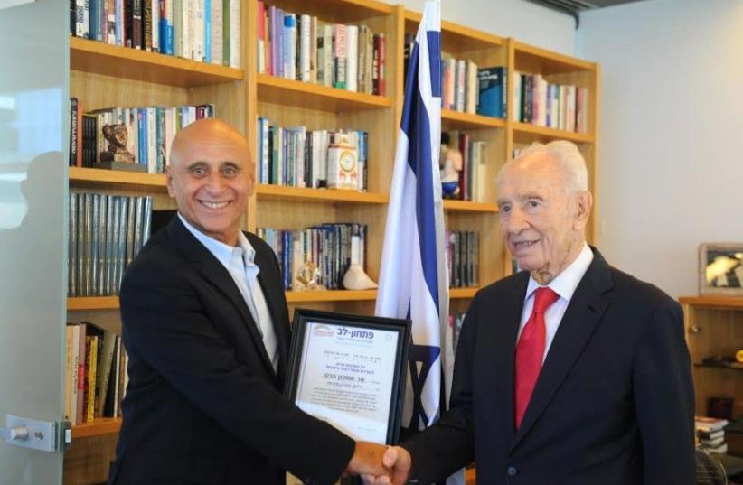 Pitchon Lev director Nisim Tzioni with late president Shimon Peres (photo credit: Courtesy)