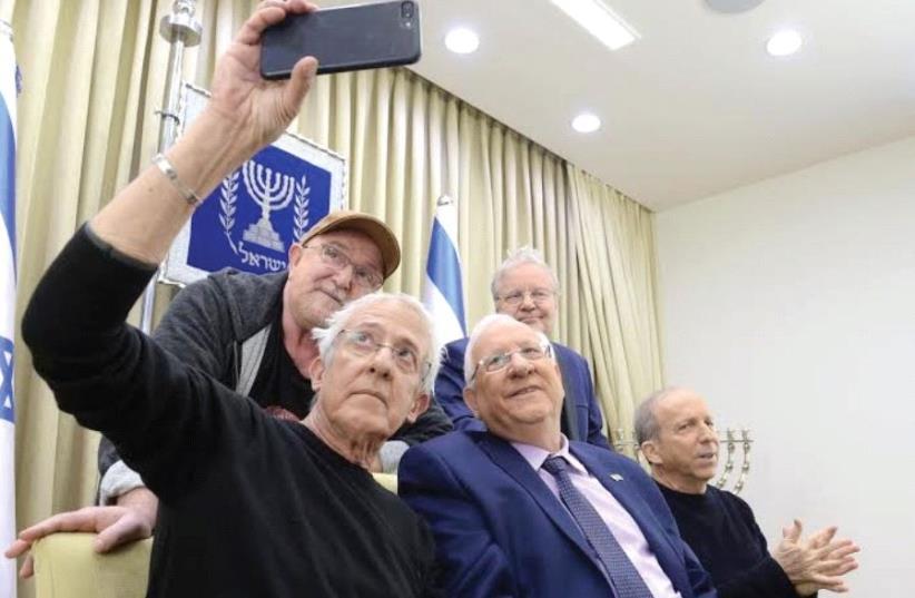 GIDI GOV takes a selfie with President Reuven Rivlin, Danny Sanderson (right), Ephraim Shamir (standing, left) and Alon Oleartchik. (photo credit: MARK NEYMAN/GPO)