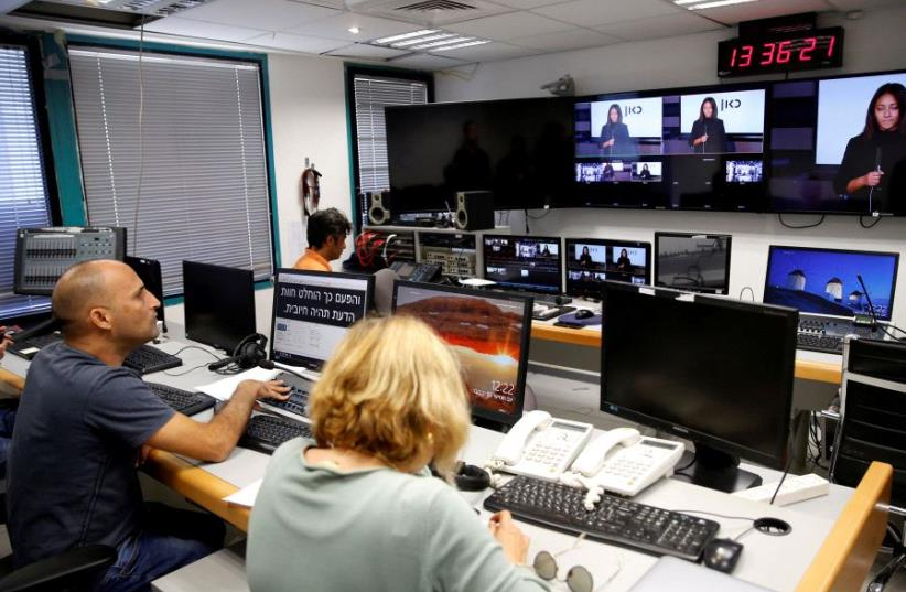 FILE PHOTO: Employees work in the offices of Kan, the new Israeli Public Broadcasting Corporation, in Tel Aviv, Israel November 3, 2016. (photo credit: REUTERS)