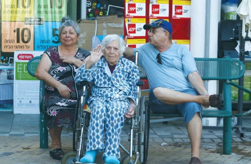 SENIORS ARE SEEN in Sderot. A baby born in Israel today can expect to live 71.7 years in good health, and about 82.1 years overall (photo credit: MARC ISRAEL SELLEM)