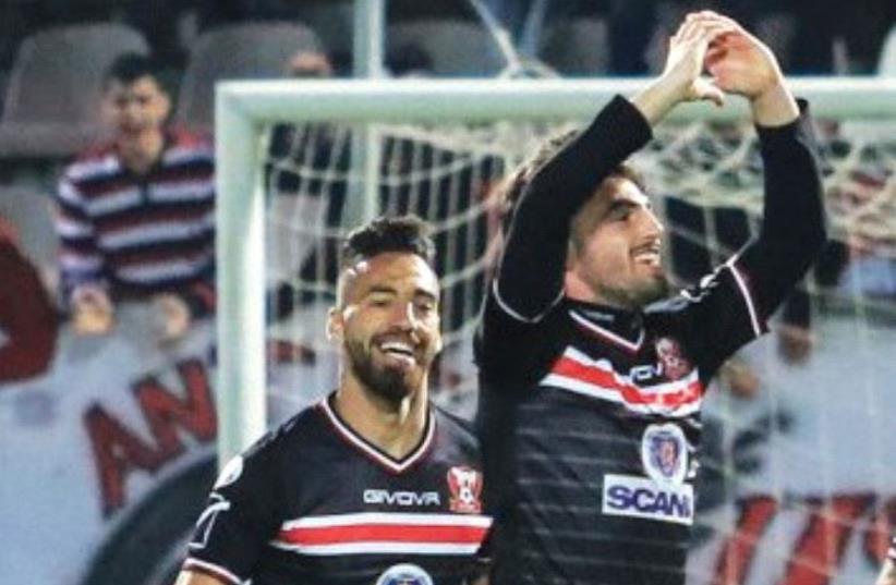 Bnei Sakhnin midfielder Nir Lax (right) celebrates after scoring the winner in last night's 1-0 victory over Maccabi Petah Tikva at Doha Stadium. (photo credit: ERAN LUF)