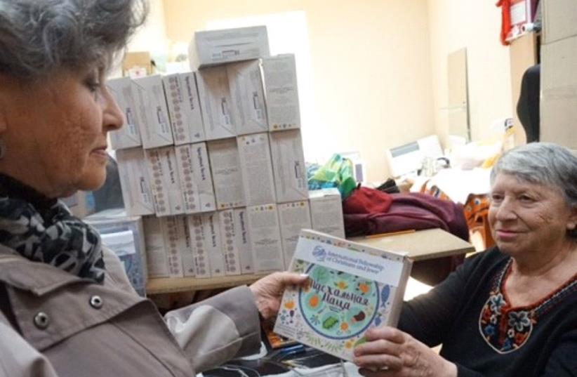 The American Joint Jewish Distribution Committee (JDC) distributes matza to elderly jews in Odessa, Ukraine. (photo credit: JDC)