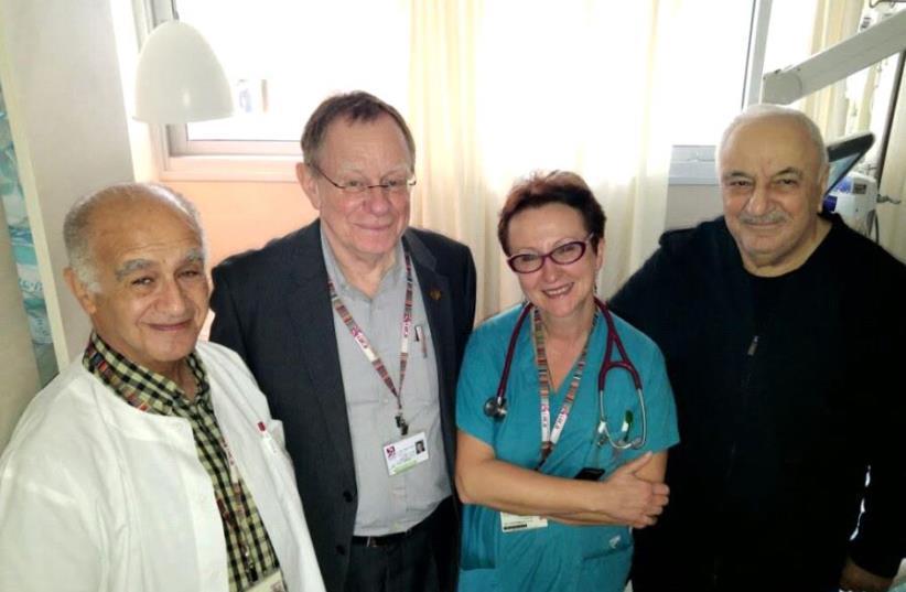 From right: Abid Sharifov, Prof. Yvgenia Nikolsky, Prof. Mahmoud Saliman and Prof. Victor Kartzman  (photo credit: RAMBAM HOSPITAL SPOKESMAN)