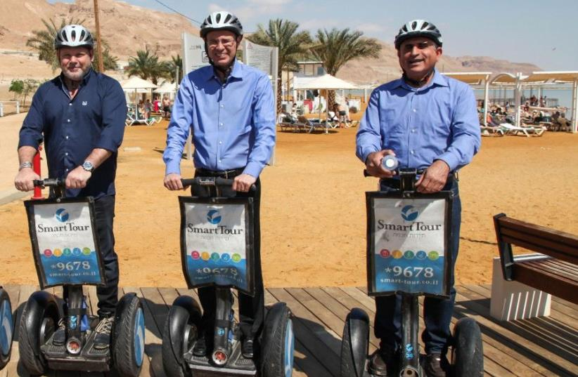Tourism Minister Yariv Levin (center) rides a Segway Monday morning down a recently completed 3 km.-long promenade off the coast of the Dead Sea.  (photo credit: TOURISM MINISTRY)