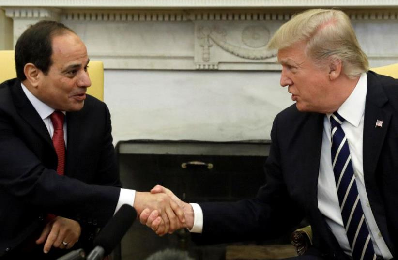 US President Donald Trump shakes hands with Egyptian President Abdel Fattah al-Sisi in the Oval Office of the White House in Washington, US, April 3, 2017. (photo credit: REUTERS)
