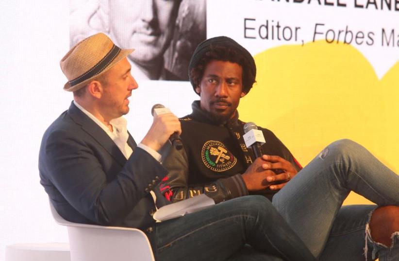 Forbes Editor Randall Lane with Amar'e Stoudemire. (photo credit: SASSON TIRAM)