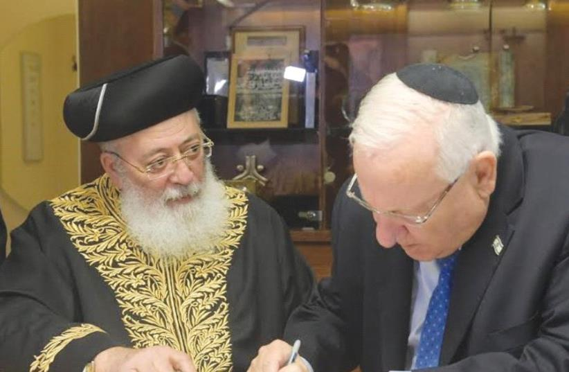 PRESIDENT REUVEN RIVLIN signs his 'contract' with Sephardi Chief Rabbi of Jerusalem Rabbi Shlomo Moshe Amar. (photo credit: AMOS BEN-GERSHOM/GPO)