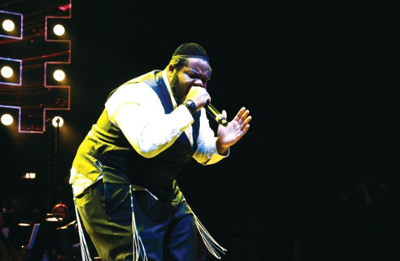 Rapper Nissim Black performs in a concert (photo credit: SHIMI KUTNER)