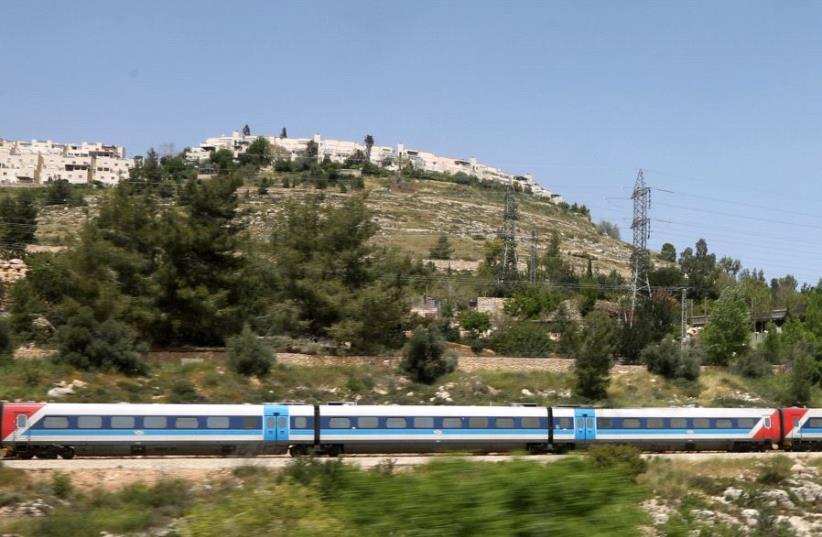 An Israel Railways train passes through Ein Yael in Jerusalem (photo credit: MARC ISRAEL SELLEM/THE JERUSALEM POST)