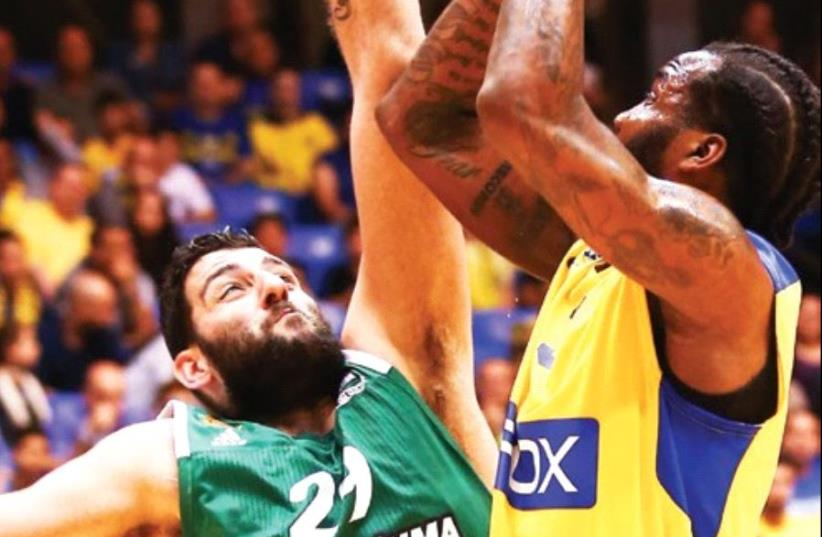 Maccabi Tel Aviv forward Victor Rudd (right) was the team's top scorer with 17 points in last night's 81-61 home loss to Panathinaikos in the final game of the Euroleague regular season (photo credit: DANNY MARON)