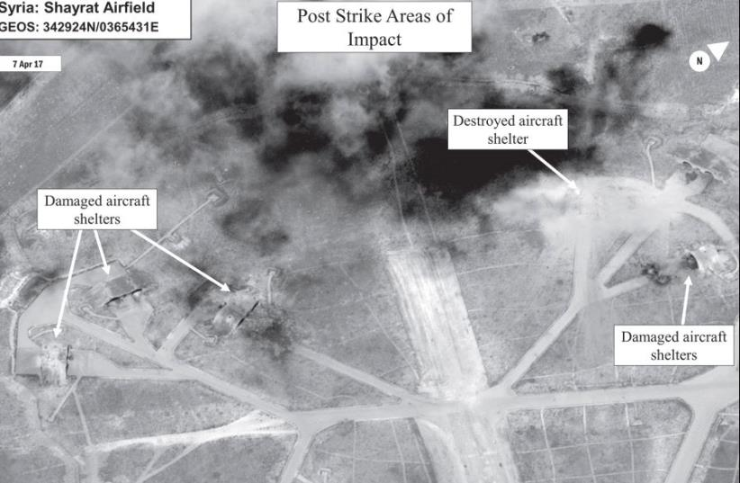 A battle damage assessment image of Shayrat airfield is seen following Friday's Tomahawk Land Attack Missile strikes from US Navy destroyers 'USS Ross' and 'USS Porter' (photo credit: DIGITALGLOBE / US DEPARTMENT OF DEFENSE / REUTERS)