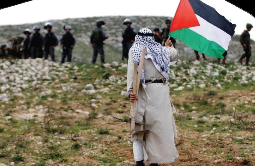 Palestinian protest (photo credit: REUTERS)