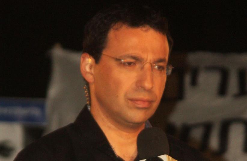 Raviv Drucker (photo credit: IDOBI/WIKIMEDIA)