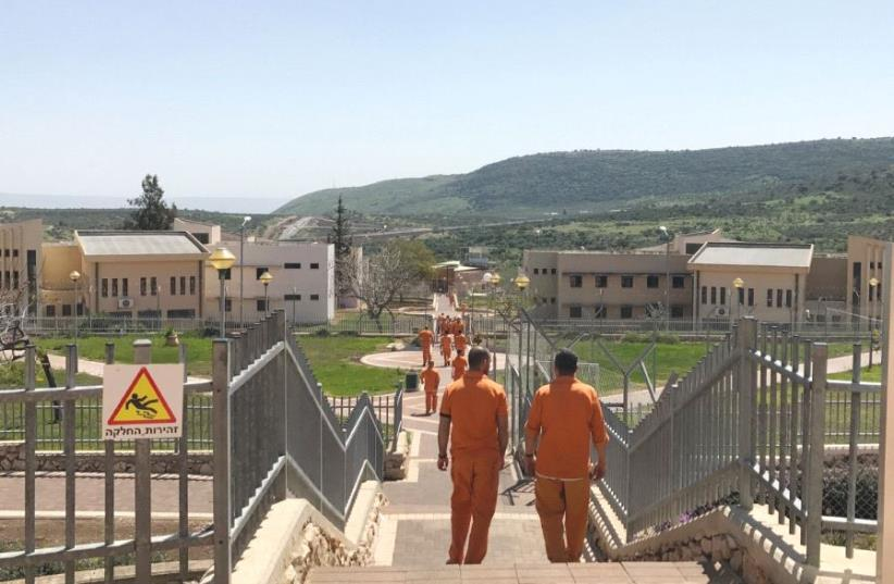 INMATES WALK through the Hermon Prison in northern Israel last week. (photo credit: ELIYAHU KAMISHER)