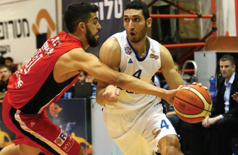 Bnei Herzliya forward Karam Mashour (right) had 15 points and nine rebounds in last night's 75-60 win over Bnei Herzliya and Tomer Ginat.  (photo credit: UDI ZITIAT)