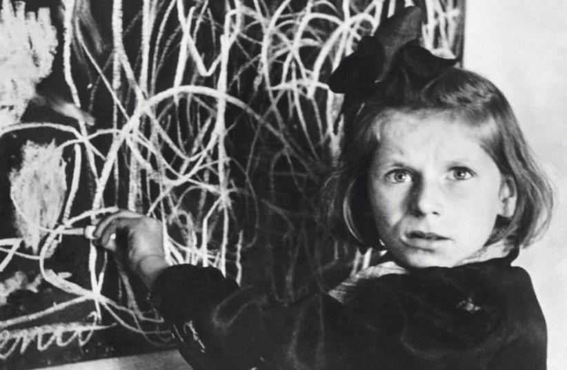 For almost 70 years, the identity of the girl in David Seymour's 1948 photo was unknown, but an article published by 'Time' on Wednesday pieced together details of her life (photo credit: DAVID SEYMOUR)