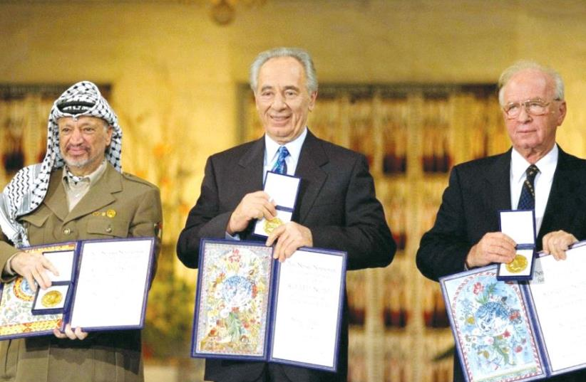 PERES receives the Nobel Peace Prize in Oslo, Norway, in 1994 alongside Yitzhak Rabin and Yasser Arafat. (photo credit: GPO)