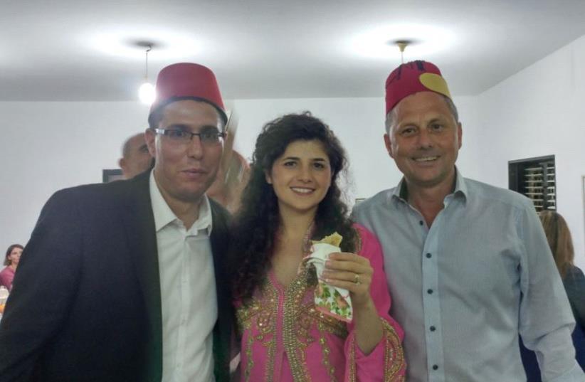 Hungarian ambassador to Israel Andor Nagy (Right), Likud MK Sharren Haskel, and Likud deputy director-general Eli Hazan at a Mimouna cebration in Holon. (photo credit: ELI HAZAN)