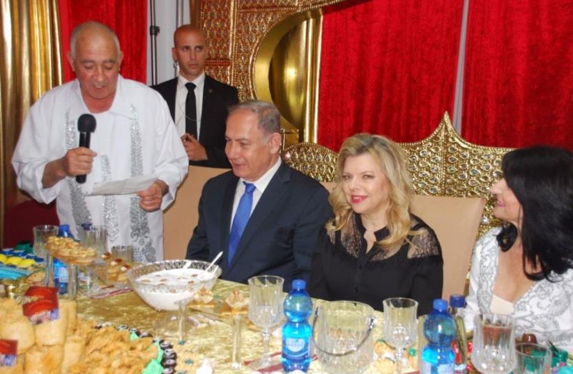 Prime Minister Benjamen Netanyahu and his wife Sarah celebrate the Mimouna in Hadera (photo credit: GPO)