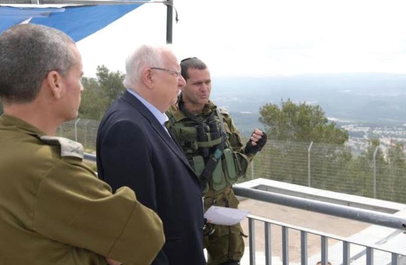 RIVLIN RECEIVES a briefing at the Lebanese border. (photo credit: AMOS BEN-GERSHOM/GPO)
