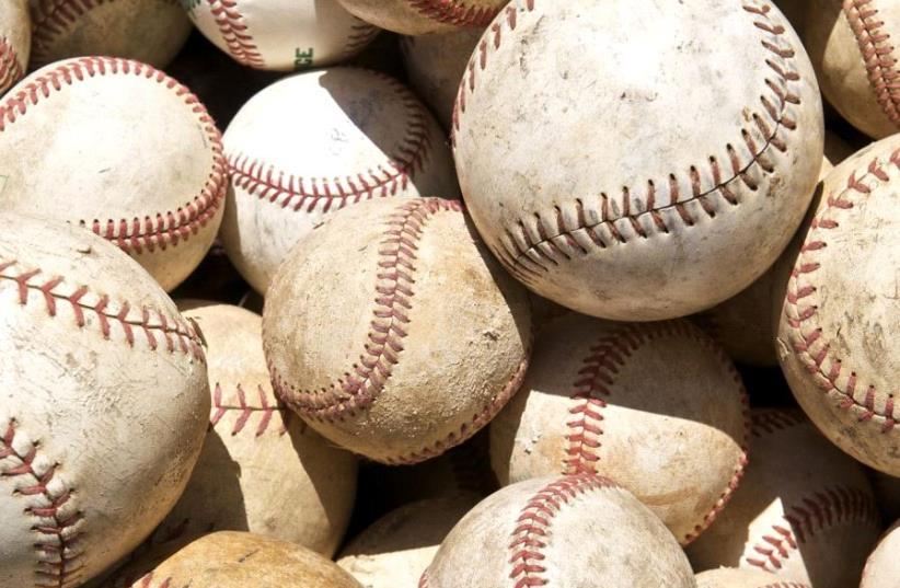 Baseballs and Softballs. (photo credit: WIKIMEDIA COMMONS/BY THOR - ORIGINALLY POSTED TO FLICKR AS BASEBALL SOFTBALL LOVE FESTIVAL.)
