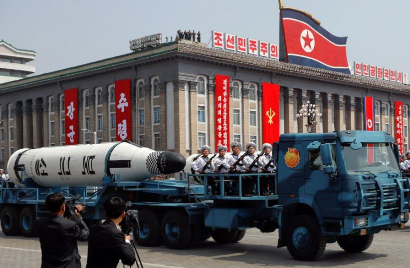 A North Korean navy truck carries the 'Pukkuksong' submarine-launched ballistic missile (SLBM) during a military parade marking the 105th birth anniversary of country's founding father, Kim Il Sung in Pyongyang, April 15, 2017 (photo credit: REUTERS)