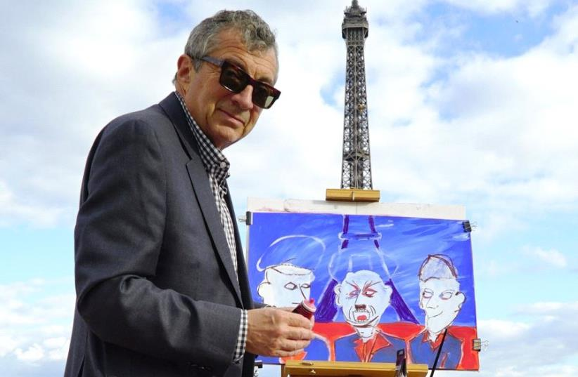 Philippe Mora painting at the Eiffel Tower in Paris , France , in the same place that Hitler stood in June 1940 (photo credit: Courtesy)