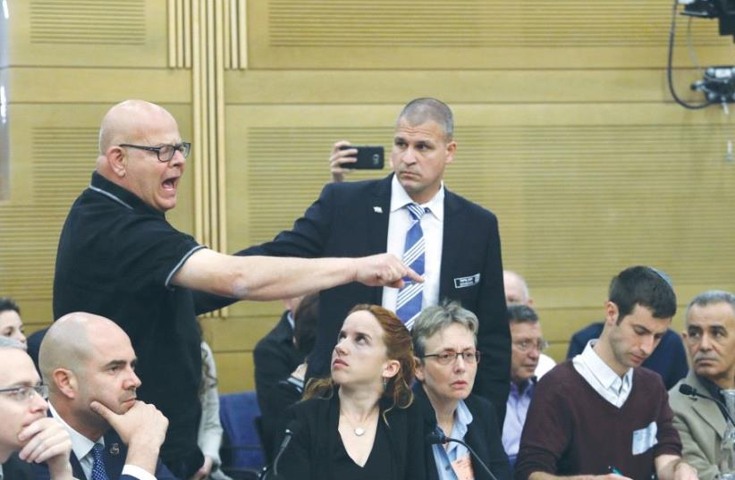 BEREAVED FATHER Ilan Sagi reacts at the Knesset State Control Committee meeting during a discussion about the Operation Protective Edge report yesterday. (photo credit: MARC ISRAEL SELLEM)