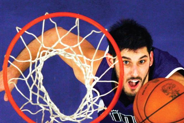 Israel national team and Minnesota Timberwolves forward Omri Casspi took part in Basketball Without Borders Europe as a player in 2005 and will do so as a guide this year, with the camp to be held at The Wingate Institute in Netanya during August, the first time the event will take place in Israel. (photo credit: REUTERS)