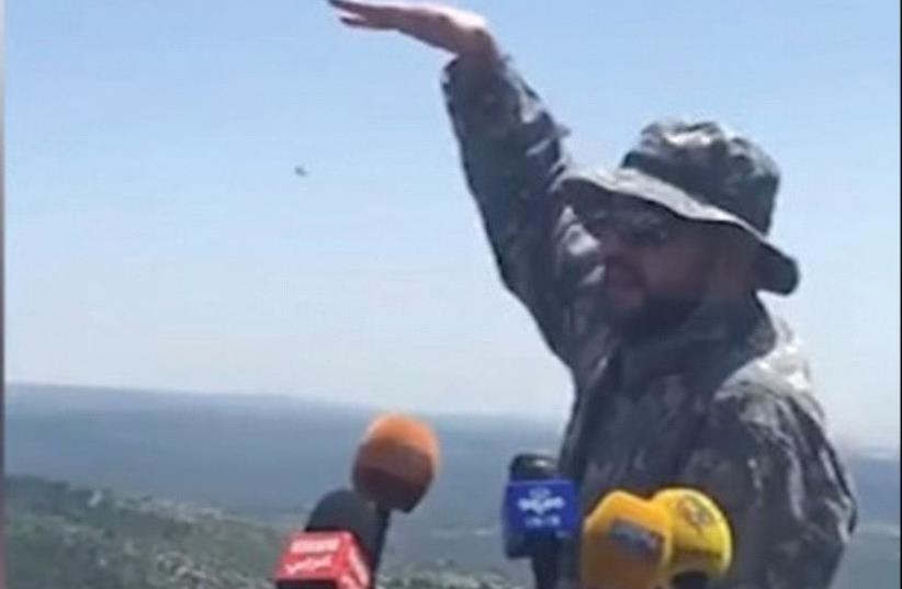 A HEZBOLLAH FIGHTER conducts a media tour of the Lebanese border with Israel yesterday (photo credit: ARAB MEDIA)