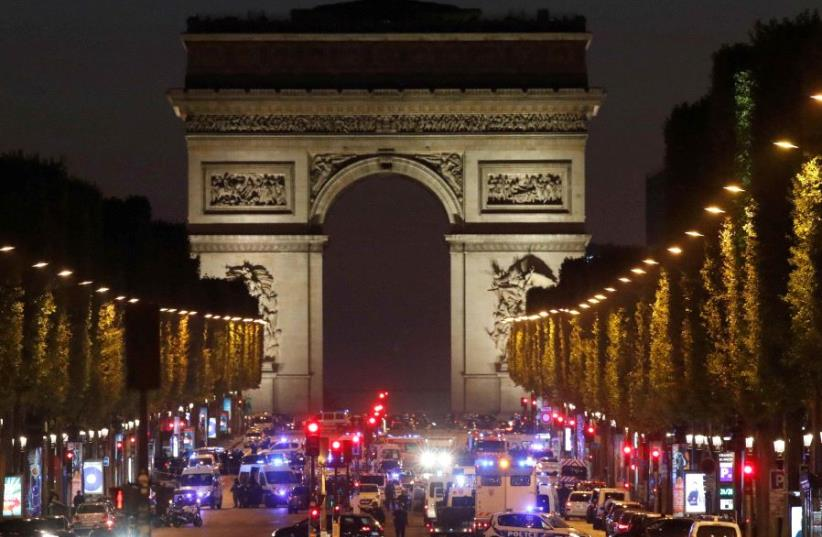 Police secure the Champs Elysees Avenue after a shooting incident in Paris, France (photo credit: REUTERS)